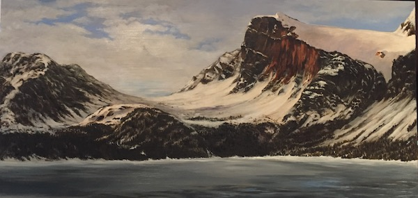 A painting of the Rocky Mountains covered in snow and a lake (Bow lake) in the foreground. Behind the mountains there is a cloudy sky.