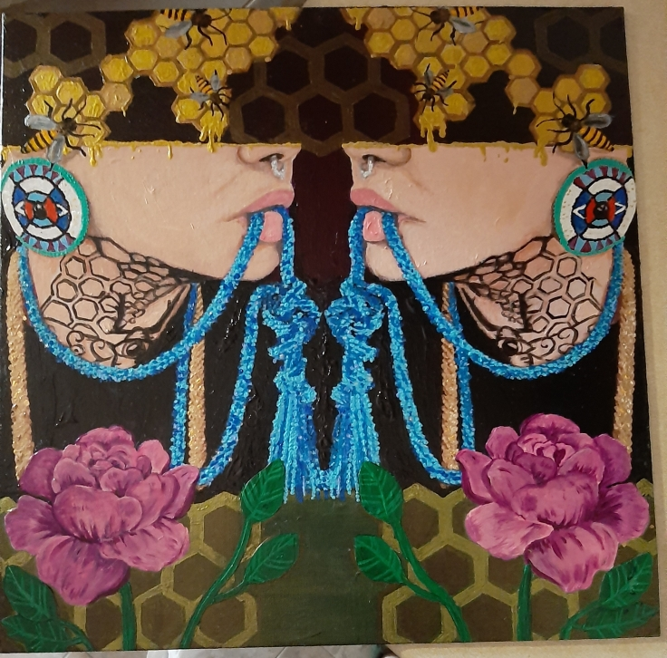 A mirror image of a person lies in the center of the painting. The person has a blue beaded necklace in their mouth, and they are wearing beautifully decorated earrings with indigenous artwork on them. The person's top half of their face is cut off, only displaying their nose, mouth, and neck. The person's neck has a tattoo consisting of honeycombs and a bee with an eye in the center of its body. Above the person, there are yellow honeycombs with bees on them. Below the person, there are two mirrored pink flowers, that are placed in front of honeycombs.