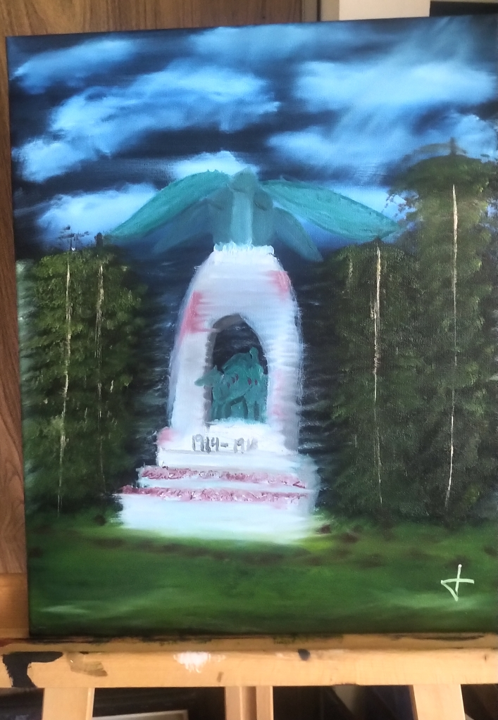 A canvas sits upon an easel. It depicts an cenotaph in memory of World War One. The cenotaph is all white with a bit of red/burgundy shading to represent the blood shed during the war. It has steps that lead to a green statue of a person on a horse. On top of the cenotaph is a winged creature that looks to be an angel. The scene of the painting takes place at night. The sky is a dark, navy blue, with with clouds that have light blue undertones. Behind the cenotaph are tall, thin pine trees, with green pines and white trunks. The ground on which the cenotaph is placed is an emerald green, with dark brown undertones representing the soil.